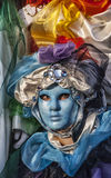 Blue Venetian Mask. Venice, Italy- February 18th, 2012: Environmental portrait of a person wearing a blue mask during the Venice Carnival days Royalty Free Stock Photos