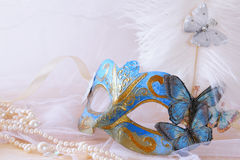 blue venetian mask next to pearls Royalty Free Stock Photography