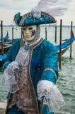 Blue Venice Mask. Full figure and gondola royalty free stock image