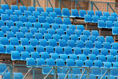 Blue venue. Empty seats in a temporary stadium Stock Photos