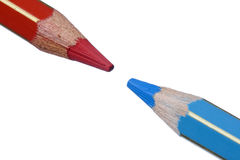 Blue versus Red Crayon Points Stock Photography