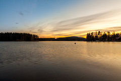Blue versus yellow. Sunset on the lake. Yellow is fighting against light blue  night Royalty Free Stock Image