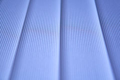 Blue vertical blinds. Abstract photo Stock Photos