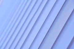 Blue vertical blinds. Soft selective focus. Blue vertical blinds. Abstract photo Royalty Free Stock Photography