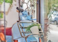 Blue Vespa in coffee shop. Close royalty free stock image