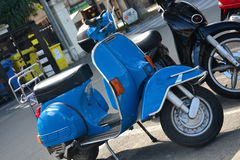 Blue Vespa scooter Royalty Free Stock Image