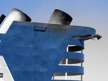 Blue vessel / ship with smokestacks in light blue sky royalty free stock photo