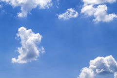Blue vibrant sky with puffy white clouds.  Royalty Free Stock Photos