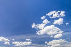Blue vibrant sky with puffy white clouds.  Stock Photo
