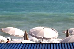 A blue view. Blue sea and parasols Stock Image