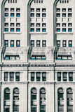 Blue view building side windows. A static architectural photo of the side of a Chicago building. Some windows gleaming with a warm blue tint Royalty Free Stock Image