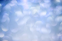Blue and vilet Bokeh Background. Festive abstract background with bokeh lights. Royalty Free Stock Images