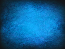 Blue Vintage abstract grunge background with bright center spotlight. Modern texture with dark corners Royalty Free Stock Photography