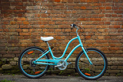 Blue vintage bicycle with old brick wall Stock Photography