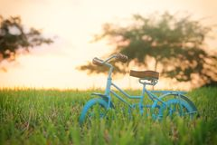 Blue vintage bicycle toy waiting outdoors at sunset light. Blue vintage bicycle toy waiting outdoors at sunset light royalty free stock photo