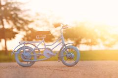 Blue vintage bicycle toy waiting outdoors at sunset light. Blue vintage bicycle toy waiting outdoors at sunset light royalty free stock images