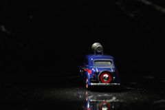 Blue vintage car in spot Royalty Free Stock Image