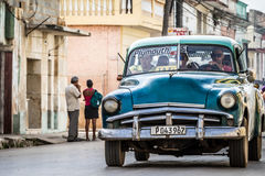Blue vintage car travelling on the street in Havana Cuba Royalty Free Stock Image