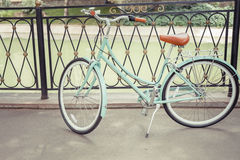 Blue vintage city bicycle, concept for activity and healthy lifestyle Stock Photos
