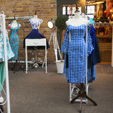 Blue vintage dress in a check on a mannequin shop around Spital stock image