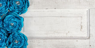 Blue vintage flowers on an old door Stock Photo