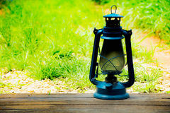 Blue vintage lamp on old wooden  background.Suitable for vintage background and country and Enter text in the middle and left Stock Photo