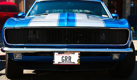Blue Vintage Muscle Car. Vintage blue muscle car with aggressive license plate Stock Photos