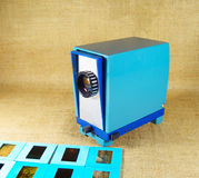 Blue vintage slide projector and slide films. Blue vintage slide projector and a slide films stock image