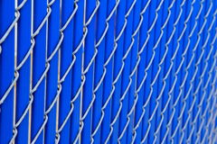 Blue vinyl and steel fencing Royalty Free Stock Photo