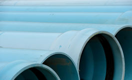 Blue vinyl water pipes Royalty Free Stock Images