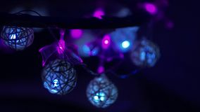 Right-to-left garland light video frame. Blue and violet blinking garland light video frame with a bokeh background stock footage