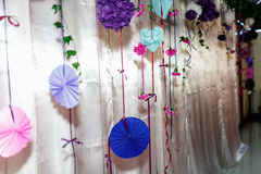 Blue, violet and pink paper decorations of a wall in restaurant Royalty Free Stock Image