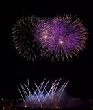 Blue, violet with red colorful fireworks in black background,artistic fireworks in Malta,Malta fireworks festival in dark sky back Stock Image