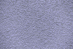 Blue violet revetment wall putty macro texture Stock Image