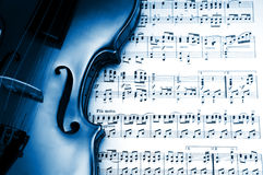 Blue violin. Detail of a classical violin on a music sheet Royalty Free Stock Images
