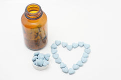 Blue vitamins with bottle. Vitamin bottle with blue vitamins Royalty Free Stock Photography