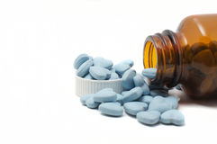 Blue vitamins with bottle Stock Image