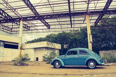 Blue Volkswagen Beetle in Front of Building Stock Photography