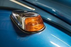 Blue Volkswagen Beetle turn signal royalty free stock photos