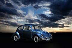Blue Volkswagen Beetle Under Blue Sky and White Clouds during Golden Hour Stock Images