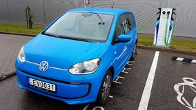 Blue volkswagen car charging electricity Royalty Free Stock Photography