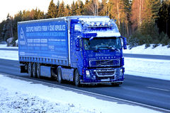 Blue Volvo FH12 460 Semi Truck Trucking in Snow and Ice. SALO, FINLAND - JANUARY 5, 2017: Blue Volvo FH12 460 of Saps Trans with frost and snow on the vehicle Stock Photography