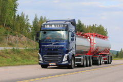 Blue Volvo FH Tank Truck Delivers Load royalty free stock image