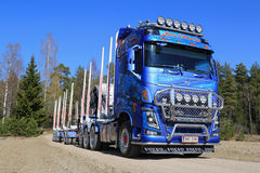 Blue Volvo FH16 750 Timber Truck on Rural Road Stock Images