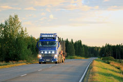 Blue Volvo FH Truck on the Road at Dusktime Stock Image