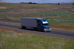 Blue Volvo Smei-Truck / White Unmarked Trailer Stock Photography