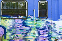 Blue waggon sprayed with colorful pattern Royalty Free Stock Photos