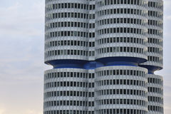 Blue waist. Modern architecture – round towers with a blue waist - office building early in the morning Stock Image
