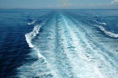 The blue wake. The blue sea in Italy - Sardinia. View from the ship Royalty Free Stock Photos