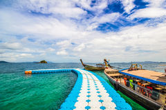 Blue walk way to long tail boat Stock Images